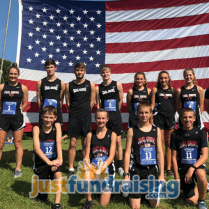 cross country team in front of flag