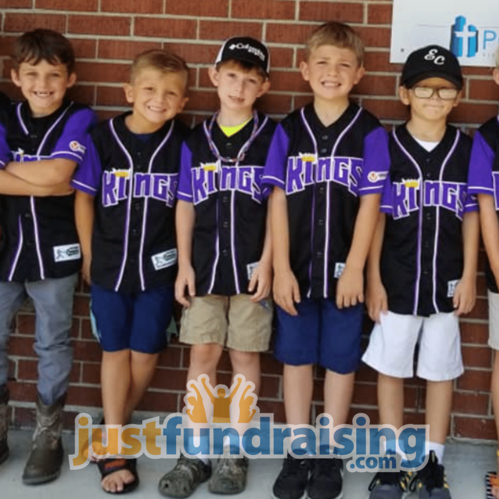 baseball team in front of brick wall
