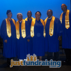 choir in stage dressed in blue