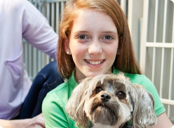 teenage girl holding a dog for a non profit fundraiser
